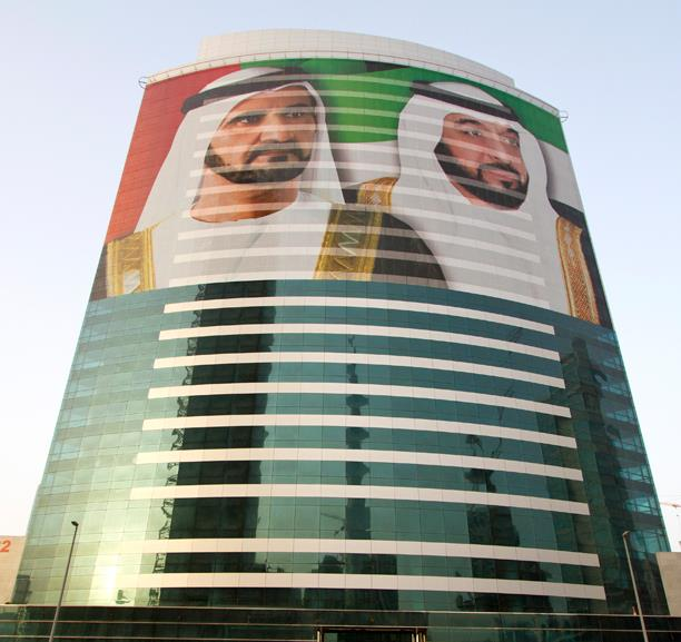 A picture of two men on a tall building in Dubai