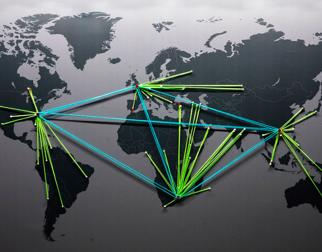 Stylized world map depicting Static Control global offices. Regional Headquarters are connected by blue lines and the offices they support are connected to the appropriate HQ by green lines.